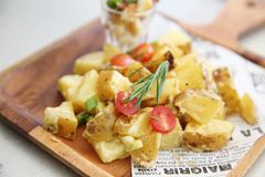 Potato salad on wooden plate. In close up stock image