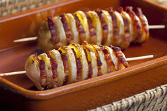 Potato skewers. Still life of potato skewers with bacon Royalty Free Stock Images
