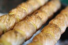 Potato on skewers Stock Image