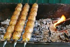 Potato on skewers Stock Photos