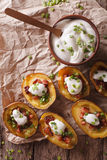 Potato skins with cheese, bacon and sour cream close-up. Vertica Stock Photography