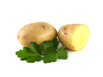 Potato with sliced half and green parsley. Potato sliced half and green parsley on white background Stock Image