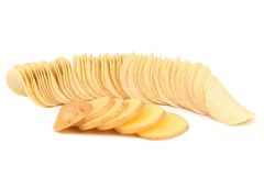 Potato slices and row of chips. Stock Image