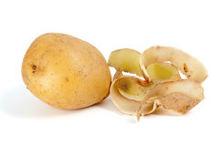 Potato and some peel. Isolated on the white background Royalty Free Stock Photos