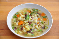 Potato Soup. A bowl of warm potato soup garnished with thyme Stock Photo