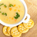 Potato Soup. Baked potato cream soup with carrot and cheese stock photo