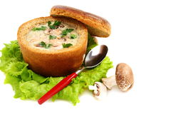 Potato soup in a bread bowl. Stock Photos