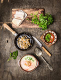 Potato soup with cracklings on old wooden table Royalty Free Stock Photo