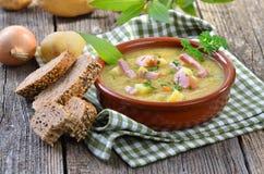 Potato soup. Freshly made potato soup with bacon strips and Vienna sausage wheels royalty free stock photos