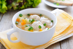 Potato soup with meatballs and chive royalty free stock photo