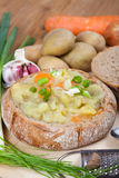Potato Soup served in loaf of bread Royalty Free Stock Photos