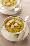 Potato soup with sliced vienna sausages and parsley Stock Images