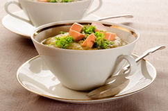 Potato soup with sliced vienna sausages and parsley Royalty Free Stock Photos