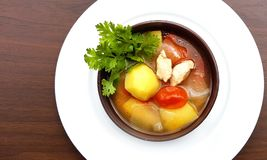 Potato soup with tomato , chicken and onion,Thailand food. royalty free stock image