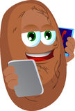 Potato speaking on a smartphone while reading a tablet Stock Images
