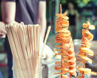 Potato spirals fried on the stands outdoors stock photo