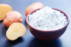 Potato starch. In bowl and on a table stock images