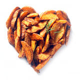 Potato or sweet potato wedges in a heart shape Royalty Free Stock Photos