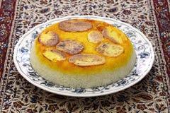 Potato tahdig, iranian rice dish. Potato tahdig, iranian persian cuisine Royalty Free Stock Photos