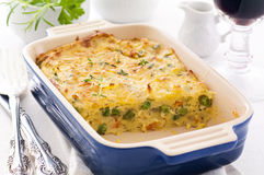 Potato terrine. In the blue baking form Royalty Free Stock Photography