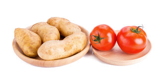 Potato and tomatos isolated on white background. Royalty Free Stock Images