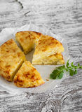 Potato tortilla. On a light wooden background Royalty Free Stock Image