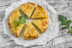 Potato tortilla. On a light wooden surface royalty free stock image