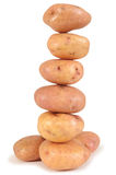 Potato tower. Fresh potatoes, isolated over white background Stock Photos