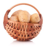 Potato tuber  in wicker basket isolated on white background Stock Images