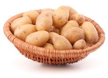 Potato tuber  in wicker basket isolated on white background Royalty Free Stock Image