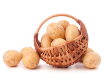 Potato tuber  in wicker basket isolated on white background Royalty Free Stock Photos