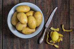 Potato tubers in a bowl Stock Photos