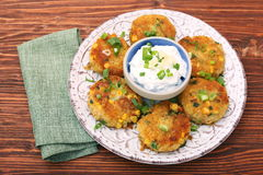 Potato and tuna patties. On wooden table Royalty Free Stock Images