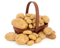 Potato Types. Charlotte new potatoes, maris piper normal and baking potato selection in a rustic basket over white background Stock Photo
