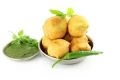 Potato vada pakoda or fritter indian food snack in pure white background Royalty Free Stock Images