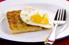 Potato waffle with fried egg Stock Photo