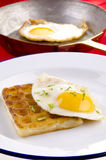 Potato waffle with fried egg Stock Image