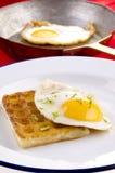 Potato waffle with fried egg Stock Image