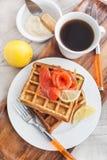 Potato waffles with salted salmon Stock Image