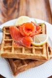 Potato waffles with salted salmon Royalty Free Stock Photo