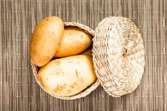 Potato in wattled box Royalty Free Stock Image