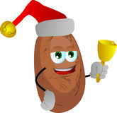 Potato wearing Santa's hat and playing bell Royalty Free Stock Photos
