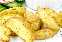 Potato wedges Stock Photos