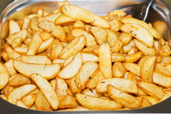 Potato wedges Stock Photos