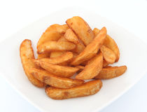 Potato wedges. Oven baked wedges with pizza deal royalty free stock images