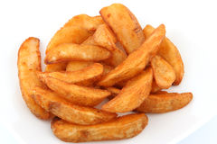 Potato wedges. Oven baked wedges with pizza deal Stock Image