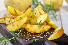 Potato wedges Stock Images