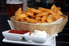 Potato wedges and beer Stock Photos
