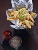 Potato Wedges. Italian Fried potato wedges with sauce royalty free stock photography