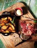 Potato Wedges and Jamon Royalty Free Stock Photos